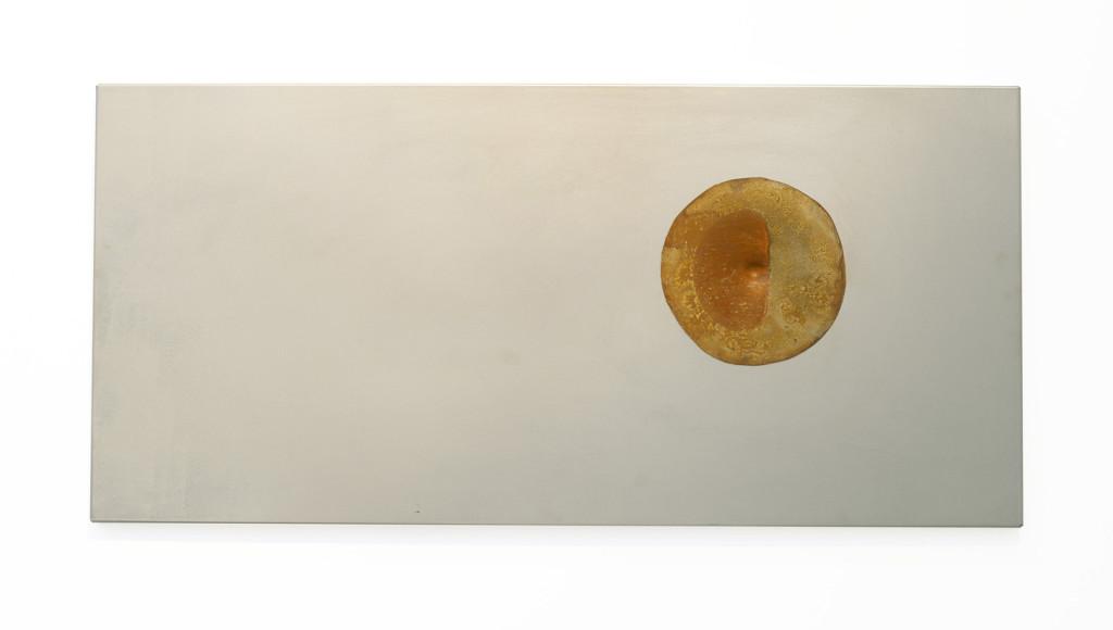 """""""Zopyra II"""", 2012. Roestig staal, .38 kogelgat, prefab ikea plaat. L 37cm, B 77.5cm."""