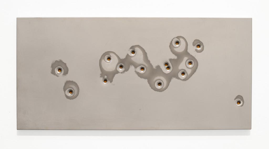 "(Verkocht) ""Zopyra I"", 2012. Roestig staal, magneten, 9mm kogelgaten, prefab ikea plaat. L 37cm, B 77.5cm."