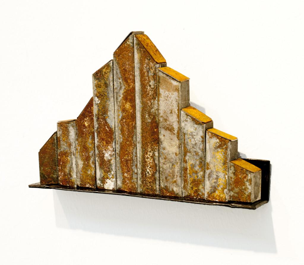 """(verkocht) """"Reprogress VIII"""" 2012. Roestig staal, RVS, magneten. L 9.5cm, B 15cm."""